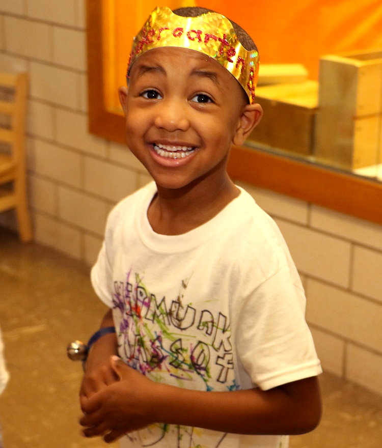 smiling boy with crown